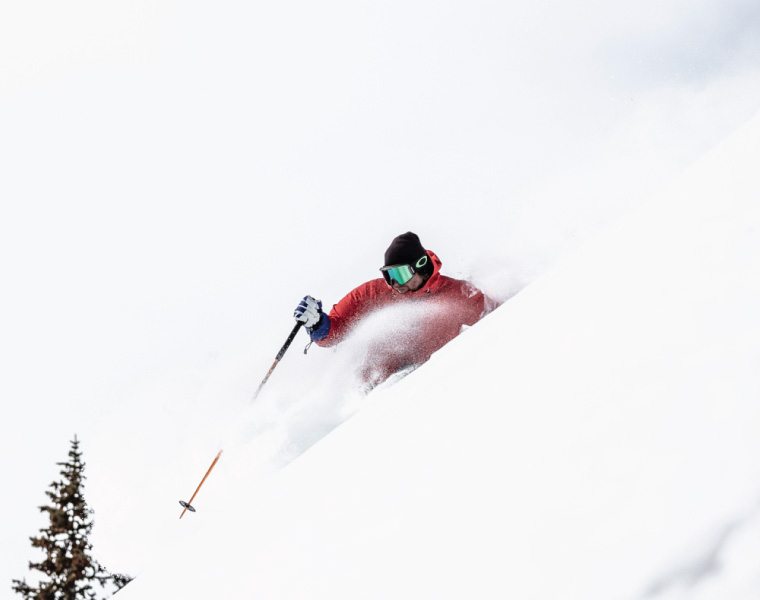 A skier turning in deep snow